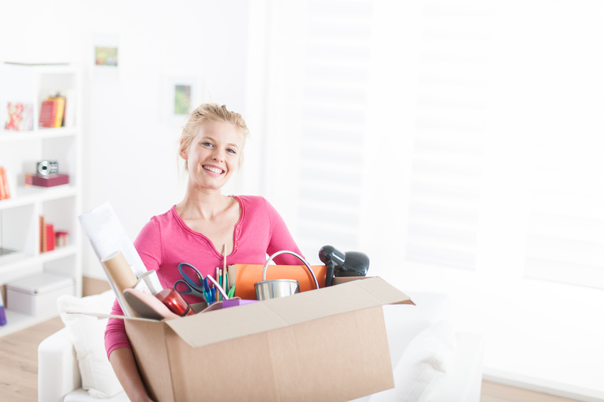 portrait of a woman moving in  a new apartment