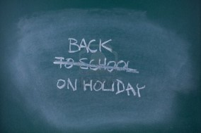 16157319-back-on-holiday-concept-writing-back-to-school-scored-out-and-replaced-with-text-back-o