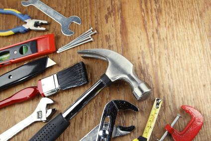Assorted tools on wood