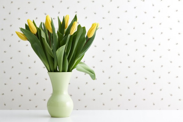 Yellow tulips in a green vase